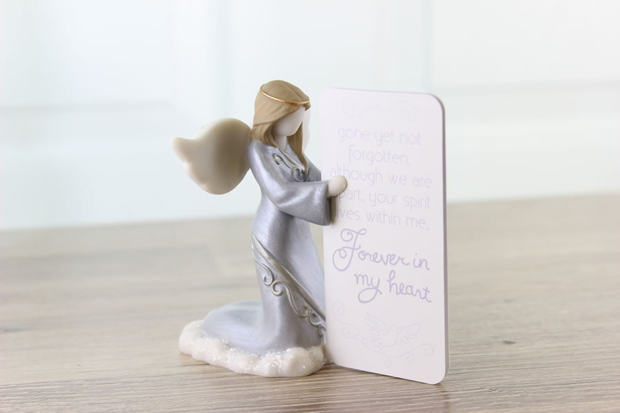 Sympathy angel figurine can hold photos between her praying hands.