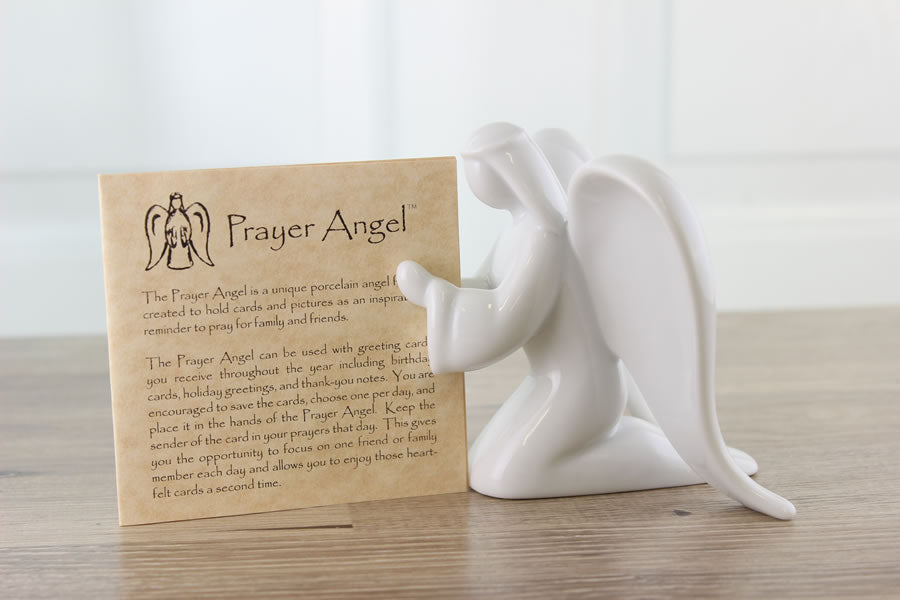 Porcelain Prayer Angel figurine with praying hands holds photos or cards, from Think Pray Gift.