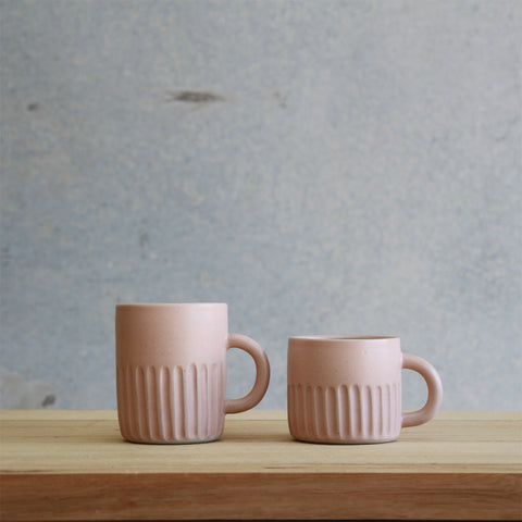 Arcadia Scott Ceramics' Fluted Mug (left) and Fluted Cup (right) in Blush glaze
