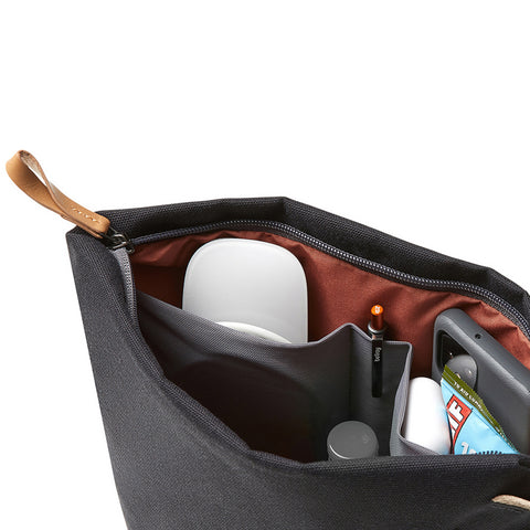 A peek inside the Bellroy Standing Pouch Plus, which has lots of little pockets for your mouse, phone, cables, headphones and more