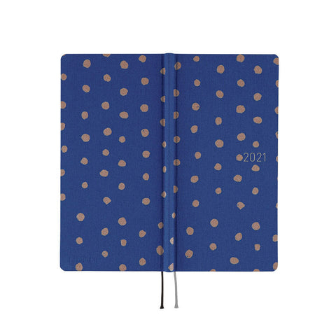 Hobonichi Techo Weeks planner open to show both sides of its patterned cover