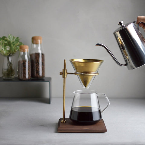 Kinto's Slow Coffee Style Brass Pourover Stand Set, with a Kinto Slow Coffee Style Kettle delivering the water