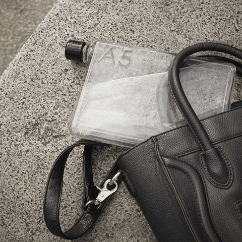 The A5 memobottle poking out of a handbag