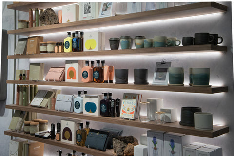 An in-store image of Milligram Chadstone, with gorgeous LED-lit shelving and beautifully styled stock