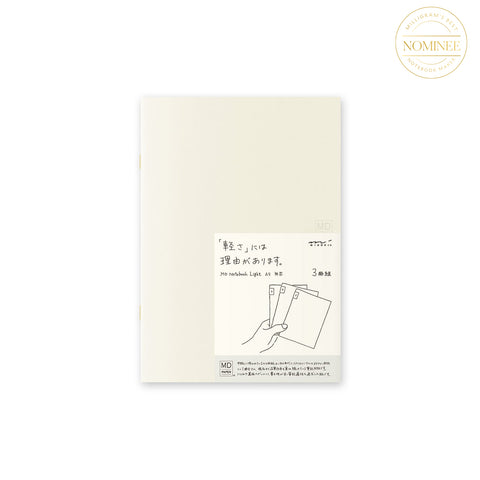Midori Light Notebook A5, with a pale creamy cover and a cover sticker featuring Japanese characters