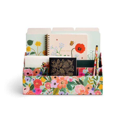 Rifle Paper Co. Desk Organiser | Milligram [img: a small storage box with multiple compartments holds notebooks, file folders, pencils and more. The storage box is wrapped in a floral print]