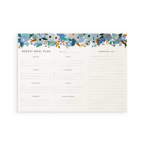 Rifle Paper Co. Weekly Meal Planner Notepad in Garden Party Blue - a large, landscape pad with room for each days' meals and a tear-off shopping list. The pad is decorated with illustrations of blue flowers along its top edge.