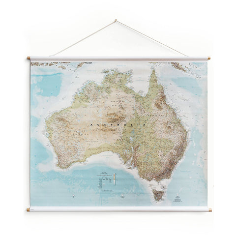 Studio Milligram Australia Wall Map, featuring a topographical map of the continent on a rectangular canvas supported by horizontal wooden poles