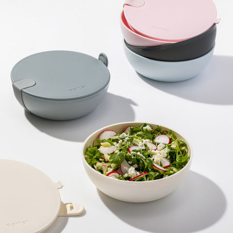 Porter Lunch Bowls in a range of colours, one filled with a delicious-looking salad