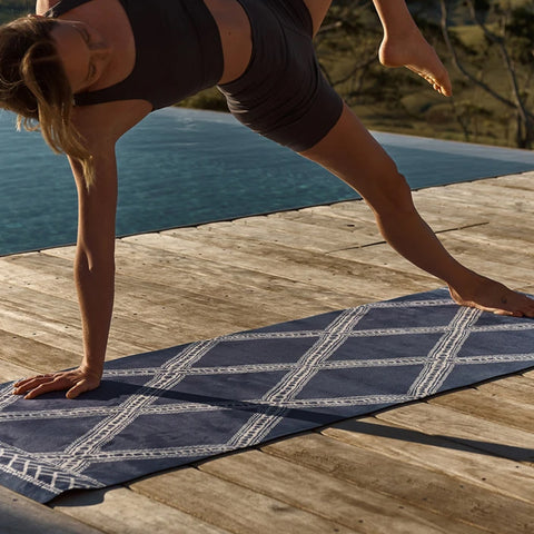 yin's Boujad yoga mat with someone doing a tricky-looking yoga pose