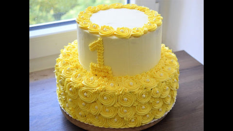 2 TIER YELLOW AND WHITE FLORAL CAKE