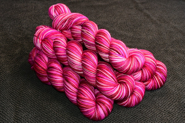 Cupid's Bow self striping sock yarn with 20g mini skein