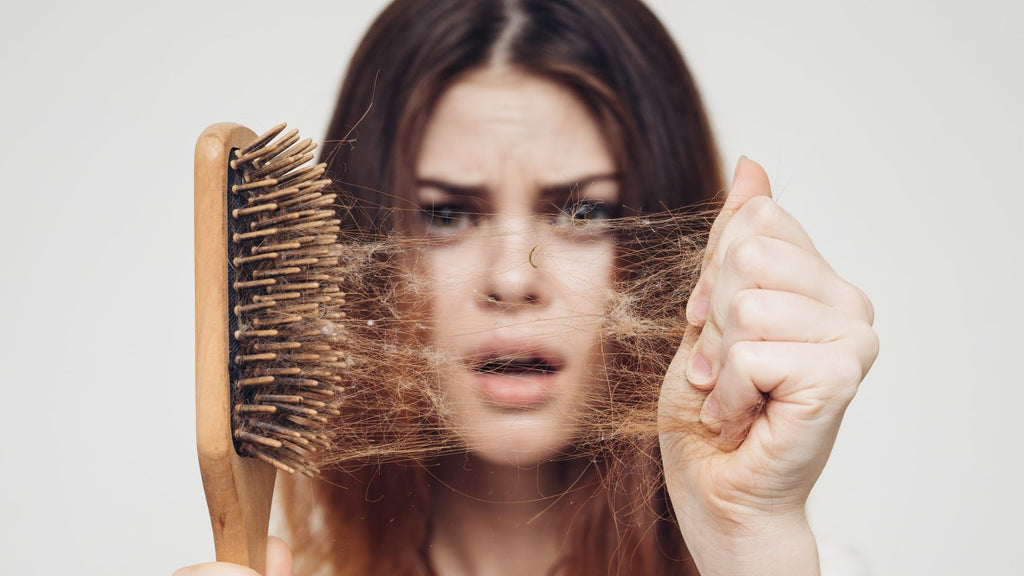 woman suffering from DHEA hair loss