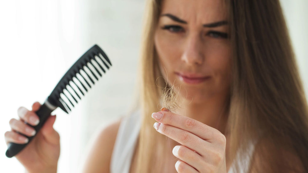 a woman seeing hair loss after combing
