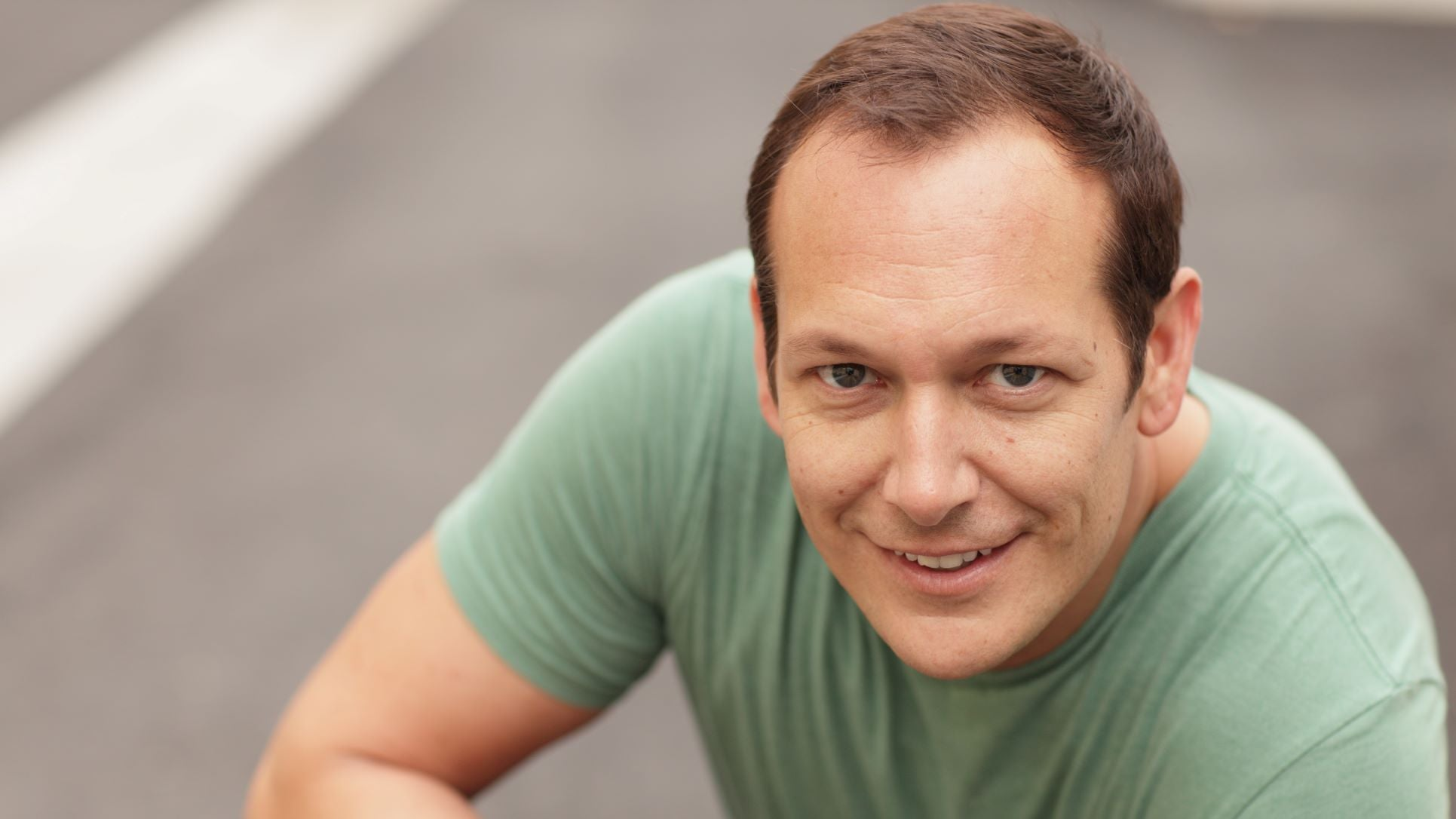 a guy smiling with receding hairline