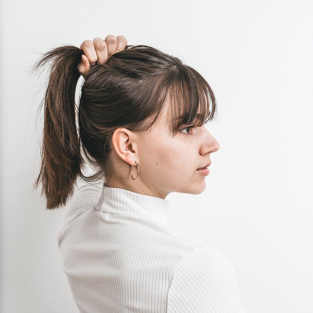 woman looking at side, ponytail