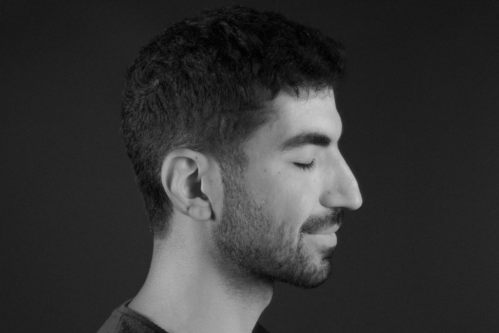 A guy side portrait, black and white and eyes closed.
