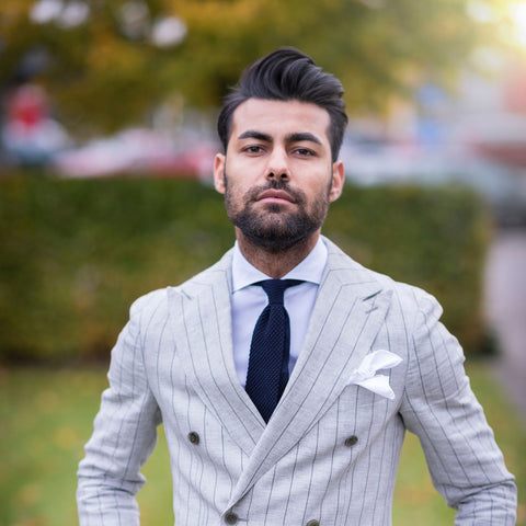 pompadour haircut guy in white suit