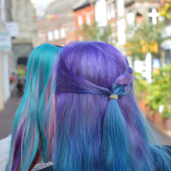two women with purple long dyed hair