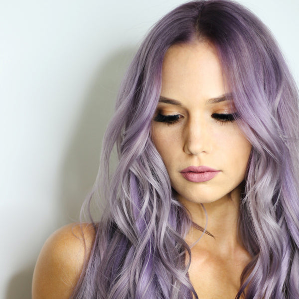 a woman with platinum dyed hair looking down