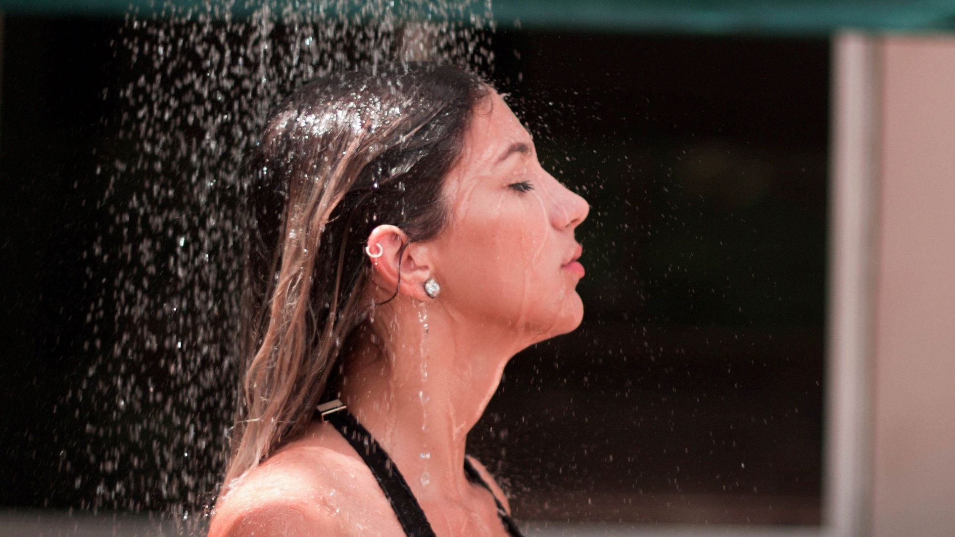 a woman showering outdoor hair fall