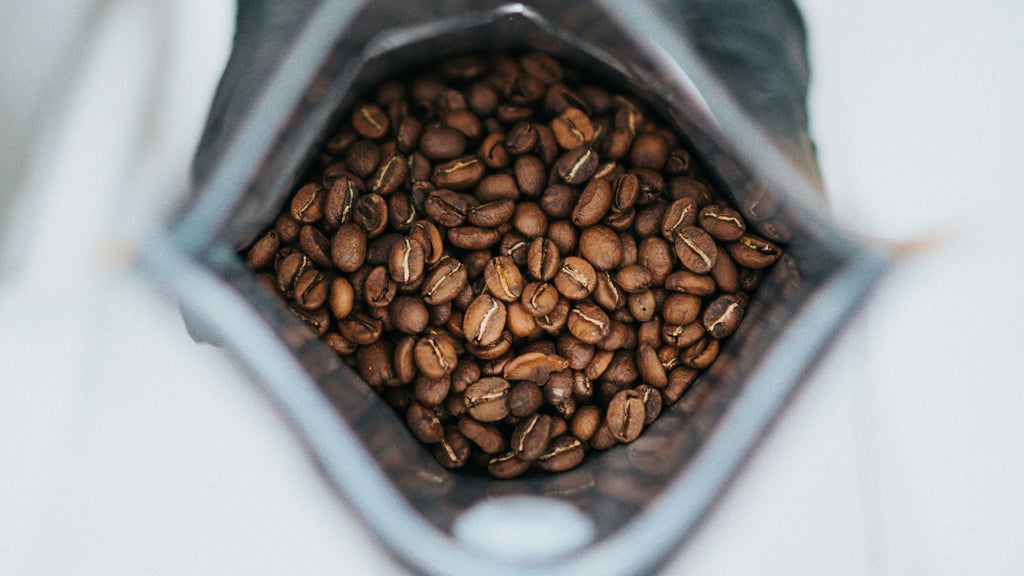 coffee beans in bag signifying caffeine