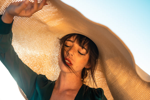 Woman with big hat to cover from UV rays