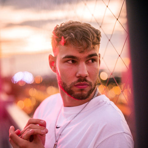 guy with sunset background french crop cut