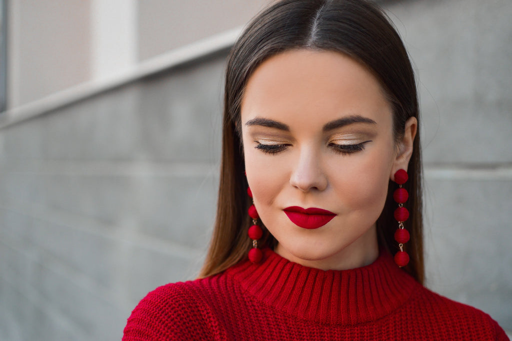woman with red lipstick, red weather, red earrings with long hair