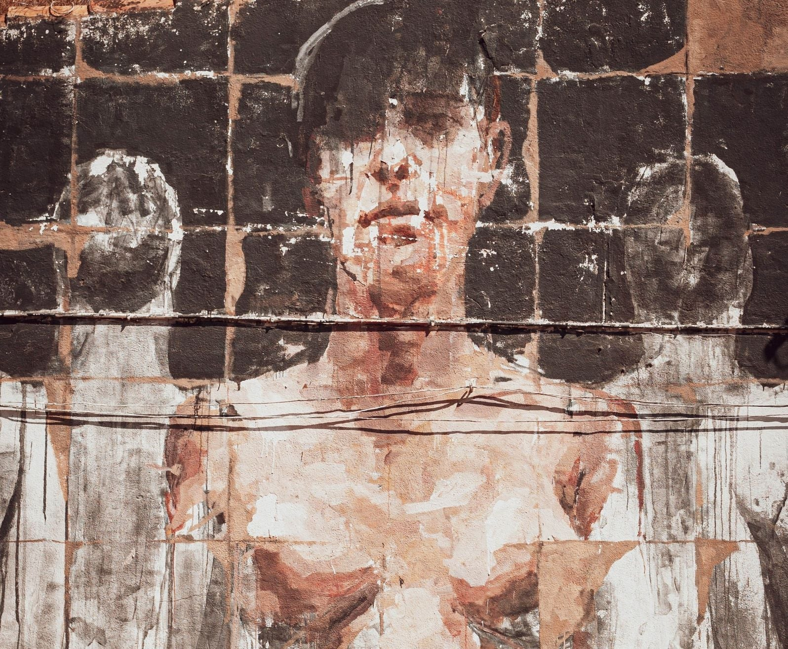 breast mural on wall