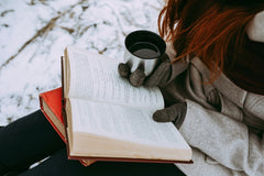 Cosy Glove and a book with a coffee