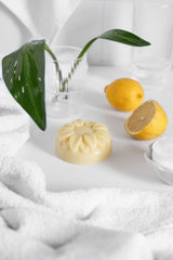 Hand Balm in bathroom with lemons and green plant