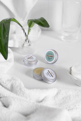 Lip Balm with a Nail Cuticle Balm in Bathroom with a Plant