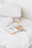 Book & candle laid on the bed