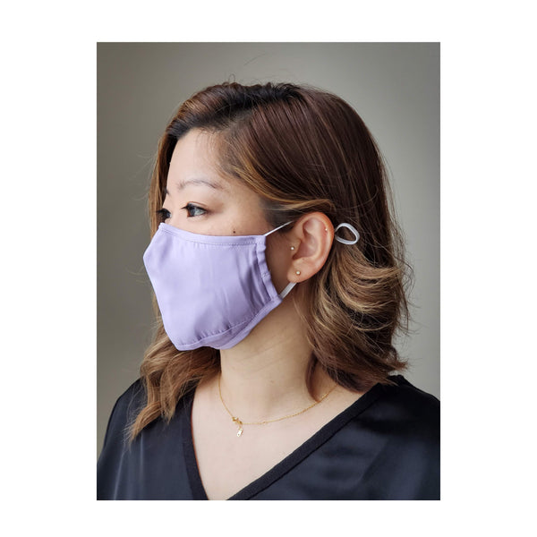 woman wearing purple face mask looking to the side