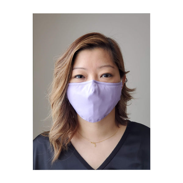 woman wearing trendy purple mask