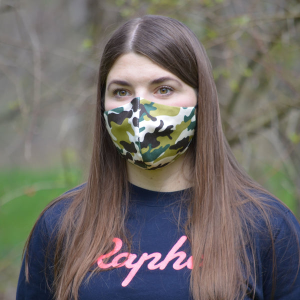 camo face mask worn on a woman