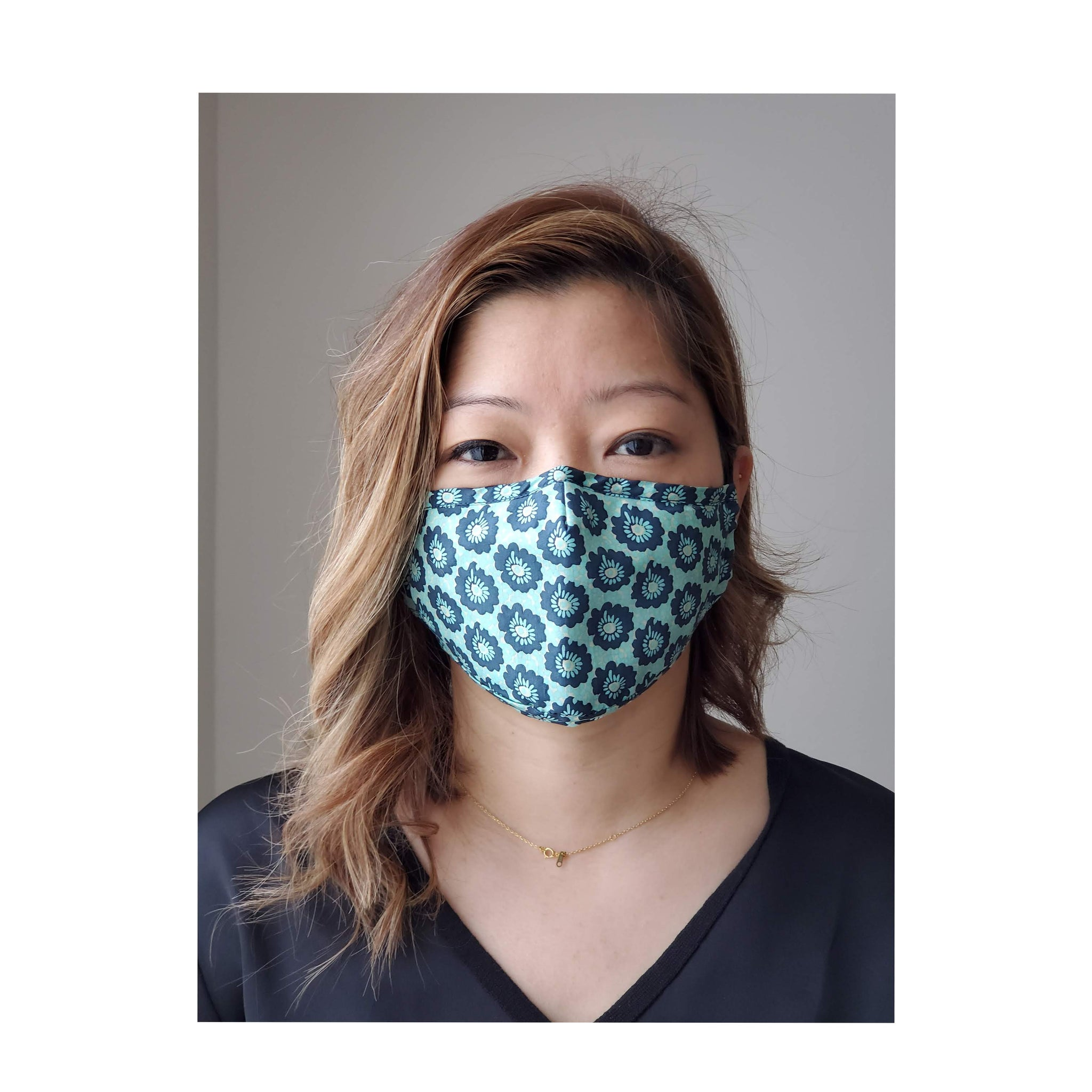 woman wearing cute blue floral face mask