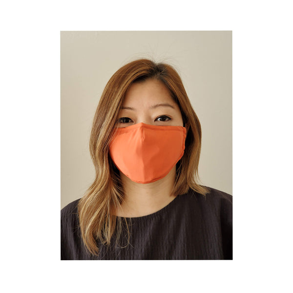 woman wearing coral face mask