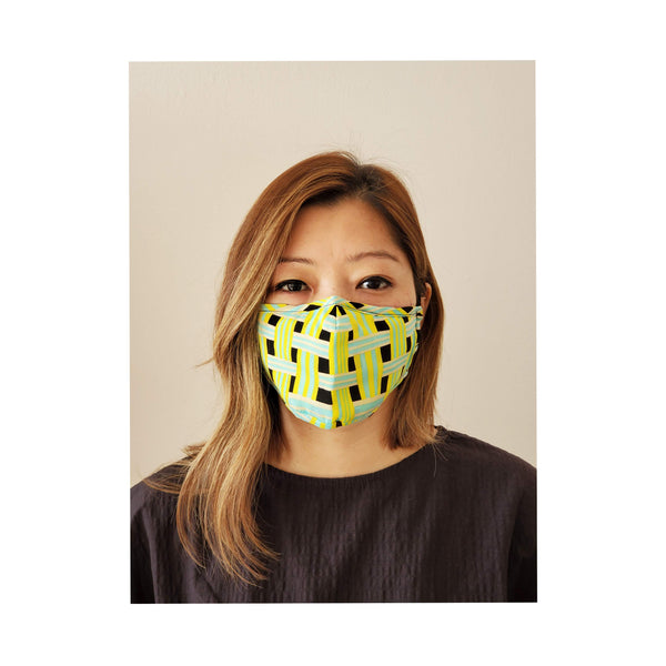 trendy neon face mask worn by woman