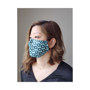 woman wearing blue floral face mask turned to the side