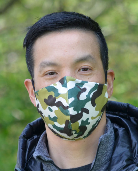 face mask with camo print worn by man