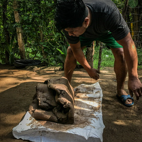Santiago prepares the clay with a traditional foot massaging