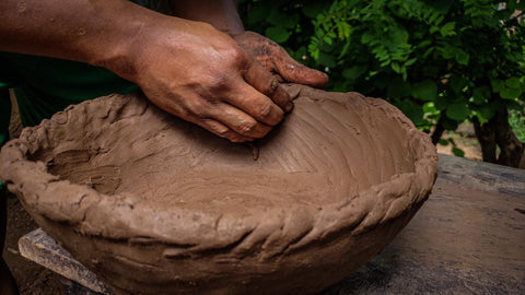 A clay base is made to build up the raw clay forms