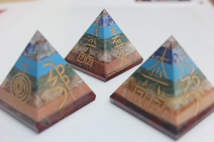 faceted Seven Chakra Stone Pyramid with reiki 4 symbols
