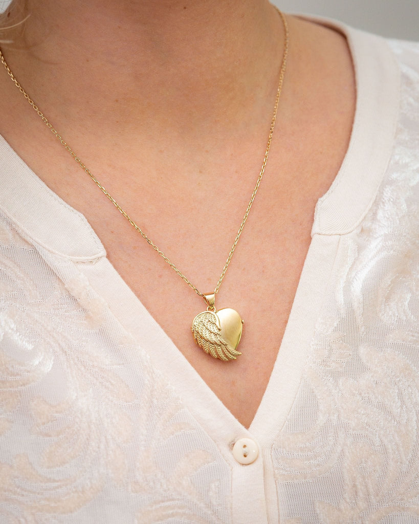 Cara Keepsakes Gold Locket Urns Gold Angel Wing Locket Urn worn on model