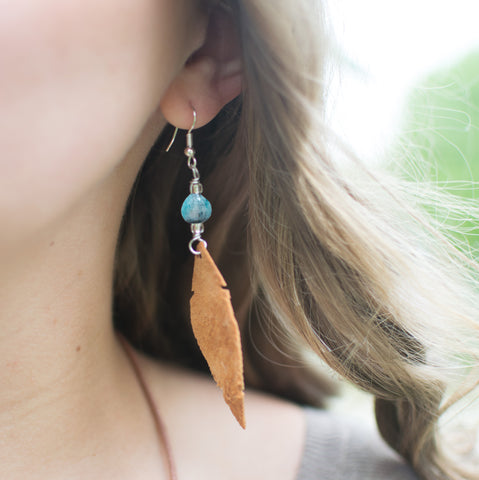 Leather feather turquoise earrings on woman
