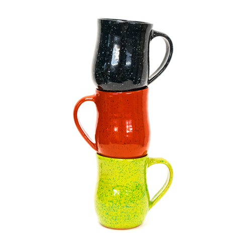 three colorful mugs stacked on each other
