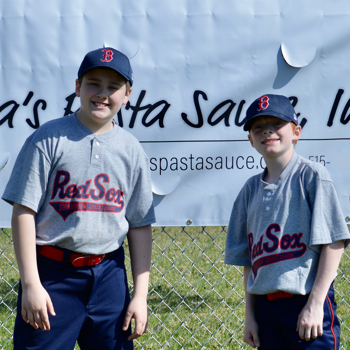 Eddie Myers and Cullen Brunk, players on the Red Sox team at Grandview Little League in Des Moines, Iowa