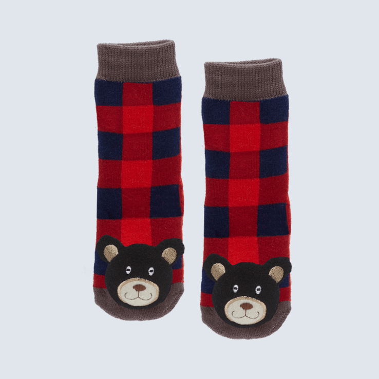 Two plaid socks against a white background. The socks feature a maple leaf and wood motifs. Each toe features a cute plush black bear.
